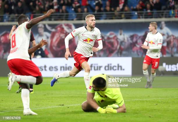 Konrad Laimer of RB Leipzig celebrates after scoring his team's first goal during the Bundesliga match between RB Leipzig and FC Augsburg at Red Bull...