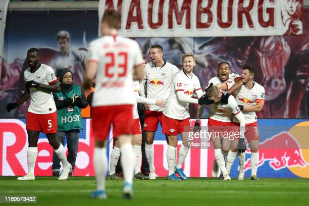 Konrad Laimer of RB Leipzig celebrates with teammates after scoring his team's third goal during the Bundesliga match between RB Leipzig and 1 FC...
