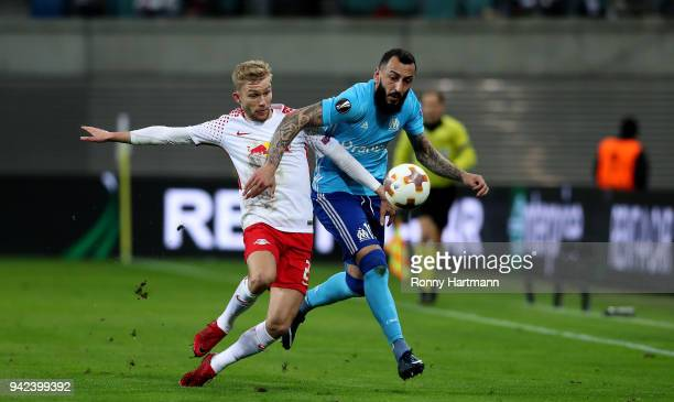 Konrad Laimer of RB Leipzig vies with Kostas Mitroglou of Olympique Marseille during the UEFA Europa League quarter final leg one match between RB...
