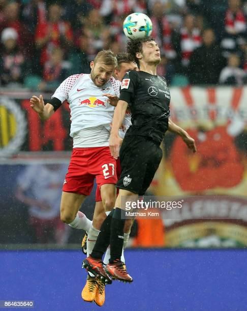 Konrad Laimer Willi Orban and Benjamin Pavard jump for a header during the Bundesliga match between RB Leipzig and VfB Stuttgart at Red Bull Arena on...