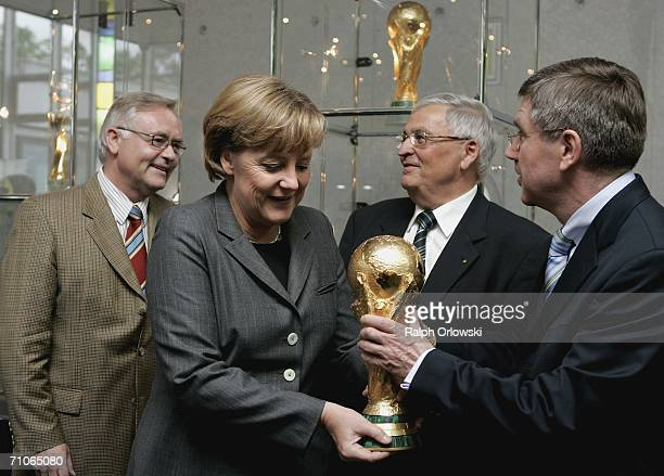 Konrad R Mueller General Secretary of the German Football Federation DFB German Chancellor Angela Merkel Theo Zwanziger President of the DFB and...