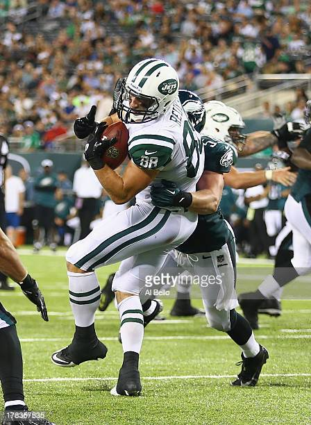 Konrad Reuland of the New York Jets makes a catch against the Philadelphia Eagles during their pre season game at MetLife Stadium on August 29 2013...