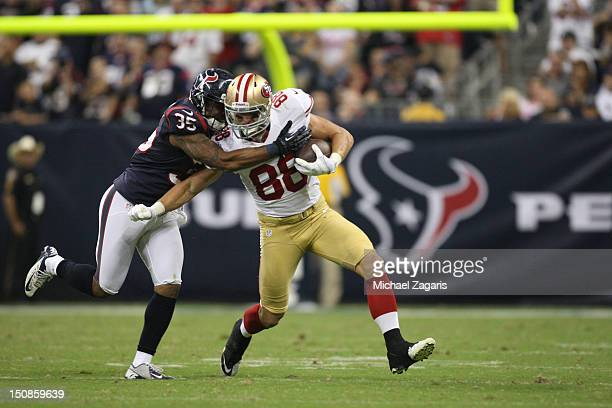 Konrad Reuland of the San Francisco 49ers gets hit after making a reception during the game against the Houston Texans at Reliant Stadium on August...