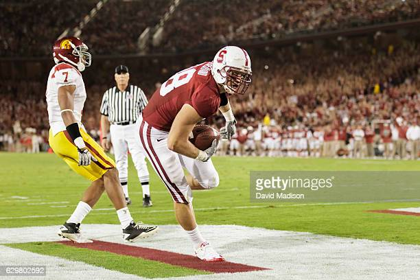 Konrad Reuland of the Stanford Cardinal catches a touchdown pass during an NCAA Pac12 football game against the USC Trojans played on October 9 2010...
