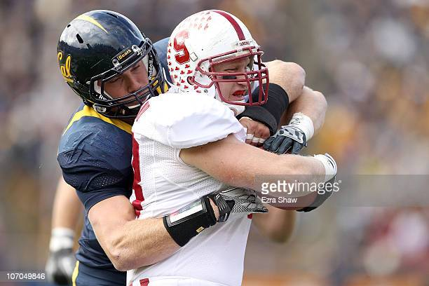 Konrad Reuland of the Stanford Cardinal is tackled by Mike Mohamed of the California Golden Bears at California Memorial Stadium on November 20 2010...