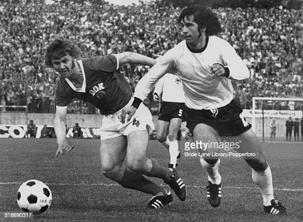 Konrad Weise of East Germany and Gerd Müller of West Germany in action during the World Cup Group 1 match at the Volksparkstadion Hamburg Germany...