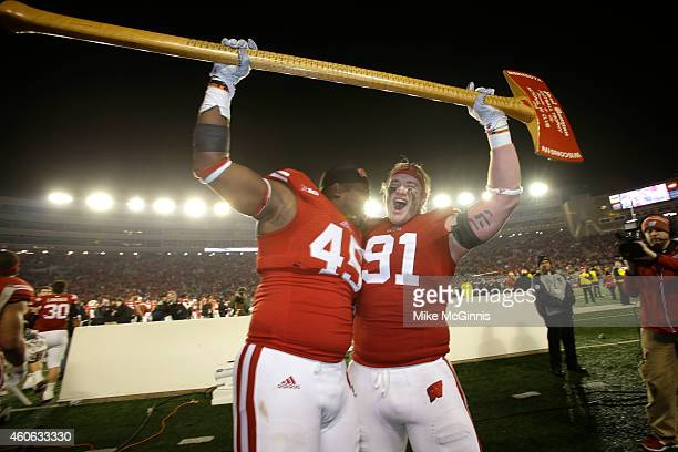 Konrad Zagzebski of the Wisconsin Badgers along with Warren Herring celebrates with the Paul Bunyan axe after the 3424 win over the Minnesota Golden...