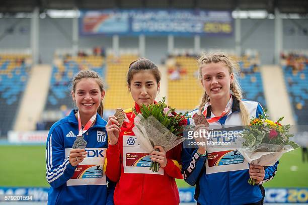 Konstadna Romeou from Greece Ting Chen from China and GeorgianaIuliana Anitei from Romania on the podium after the women's triple jump during the...