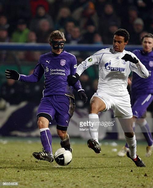 Konstantin Engel of Osnabruck and Joel MAtip of Schalke battle for the ball during the DFB Cup quarter final match between VfL Osnabrueck and FC...