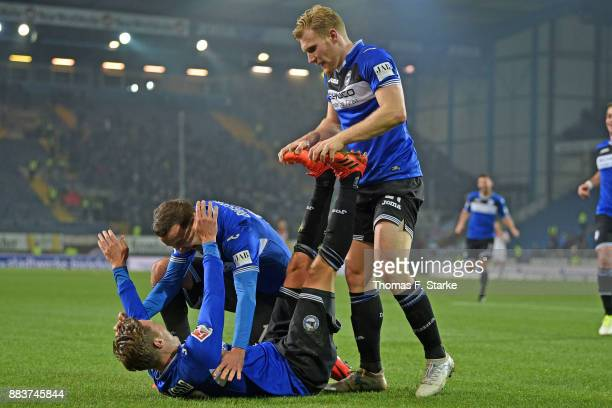 Konstantin Kerschbaumer Manuel Prietl and Andreas Voglsammer of Bielefeld celebrate during the Second Bundesliga match between DSC Arminia Bielefeld...