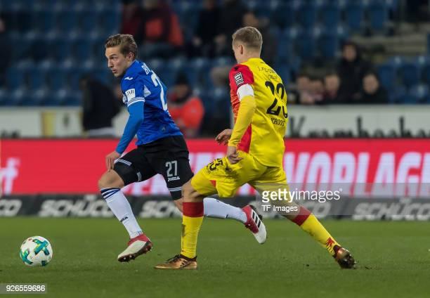 Konstantin Kerschbaumer of Bielefeld and Felix Kroos of Berlin battle for the ball during the Second Bundesliga match between Arminia Bielefeld and...
