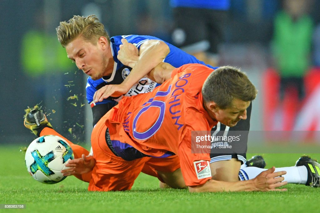 Konstantin Kerschbaumer (BACK) of Bielefeld and Thomas Eisfeld of Bochum fight for the ball during the Second Bundesliga match between DSC Arminia Bielefeld and VfL Bochum 1848 at Schueco Arena on August 21, 2017 in Bielefeld, Germany.