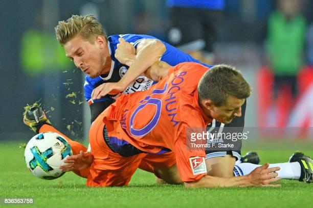 Konstantin Kerschbaumer of Bielefeld and Thomas Eisfeld of Bochum fight for the ball during the Second Bundesliga match between DSC Arminia Bielefeld...