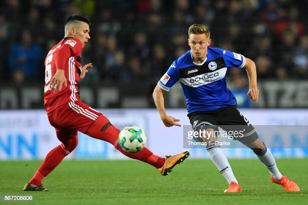Konstantin Kerschbaumer of Bielefeld kicks the ball past Alfredo Morales of Ingolstadt during the Second Bundesliga match between DSC Arminia...