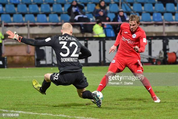 Konstantin Kerschbaumer of Bielefeld misses to score against goalkeeper Felix Dornebusch of Bochum during the Second Bundesliga match between VfL...