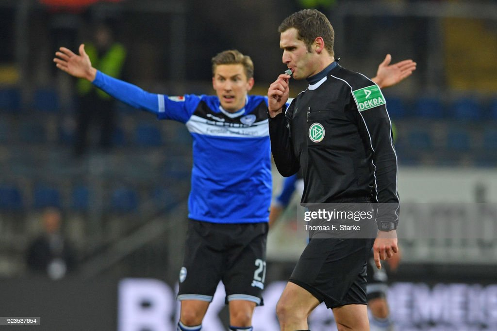 Konstantin Kerschbaumer (L) of Bielefeld reacts as referee Christof Guensch whistles during the Second Bundesliga match between DSC Arminia Bielefeld and SG Dynamo Dresden at Schueco Arena on February 23, 2018 in Bielefeld, Germany.