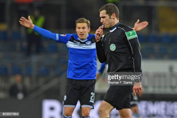 Konstantin Kerschbaumer of Bielefeld reacts as referee Christof Guensch whistles during the Second Bundesliga match between DSC Arminia Bielefeld and...
