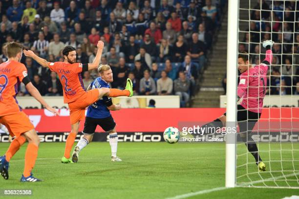 Konstantin Kerschbaumer of Bielefeld scores against goalkeeper Manuel Riemann of Bochum during the Second Bundesliga match between DSC Arminia...