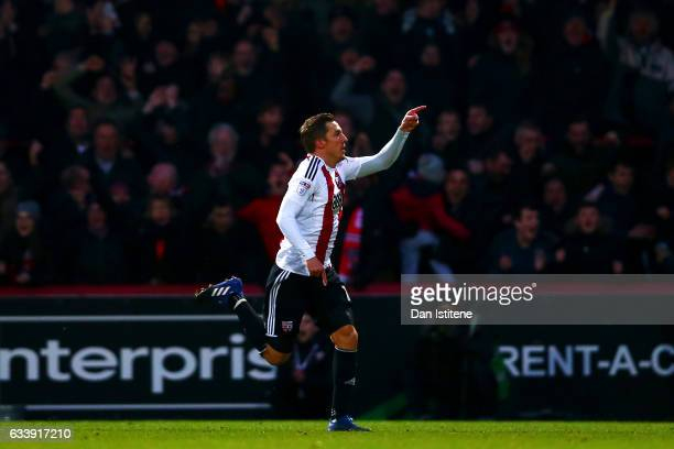 Konstantin Kerschbaumer of Brentford celebrates after scoring his team's third goal during the Sky Bet Championship match between Brentford and...