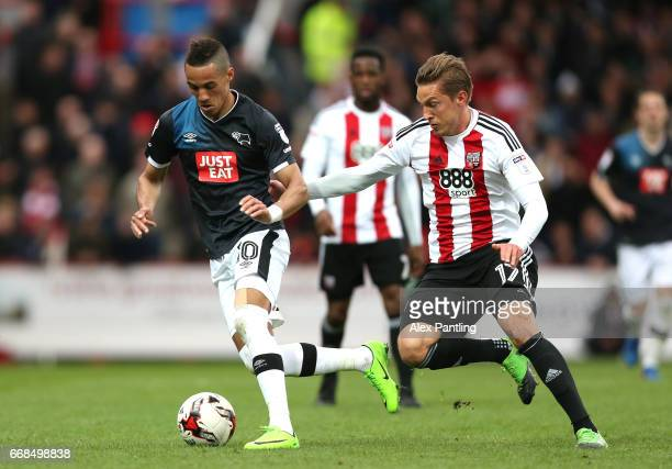 Konstantin Kerschbaumer of Brentford chases down Thomas Ince of Derby County during the Sky Bet Championship match between Brentford and Derby County...