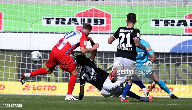 Konstantin Kerschbaumer of Heidenheim scores his team's winning goal during the Second Bundesliga match between 1. FC Heidenheim 1846 and Hamburger...