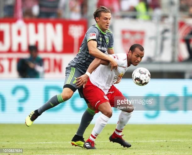 Konstantin Kerschbaumer of Ingolstadt 04 challenges Jann George of Jahn Regensburg during the Second Bundesliga match between SSV Jahn Regensburg and...
