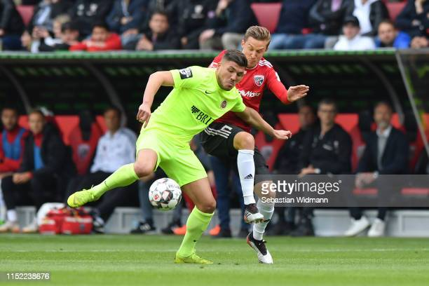 Konstantin Kerschbaumer of Ingolstadt challenges Goekhan Guel of Wehen Wiesbaden for the ball during the Second Bundesliga playoff second leg match...