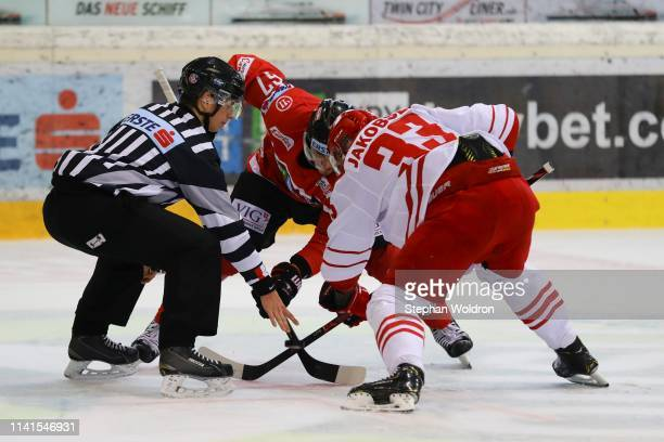 Konstantin Komarek of Austria and Julian Jakobsen of Denmark during the Austria v Denmark - Ice Hockey International Friendly at Erste Bank Arena on...