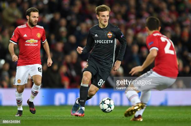 Konstantin Kuchaev of CSKA Moscow attempts to get past Ander Herrera of Manchester United during the UEFA Champions League group A match between...