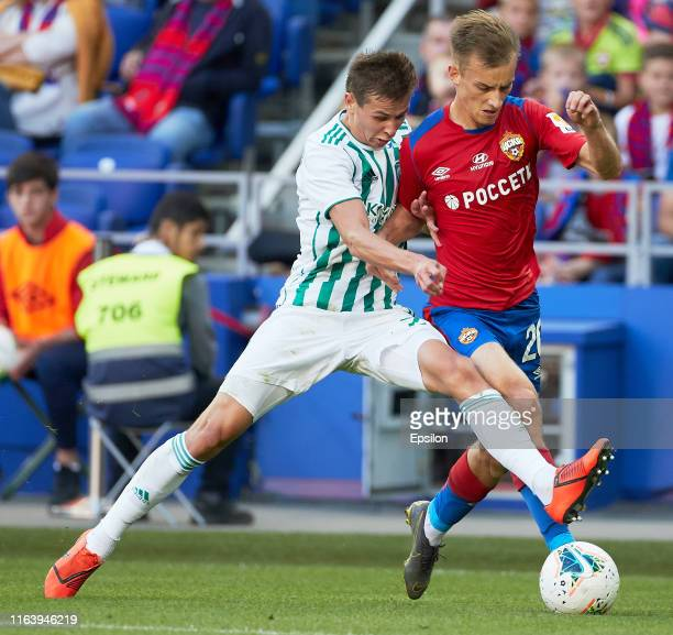 Konstantin Kuchayev of PFC CSKA Moscow and Lechi Sadulayev of FC Akhmat Grozny vie for the ball during the Russian Football League match between PFC...