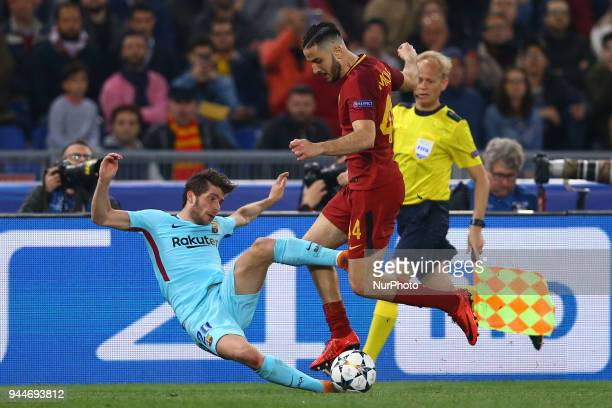 Konstantin Manolas of Roma tackling on Sergi Roberto of FC Barcelona at Olimpico Stadium in Rome Italy on April 10 during UEFA Champions League...