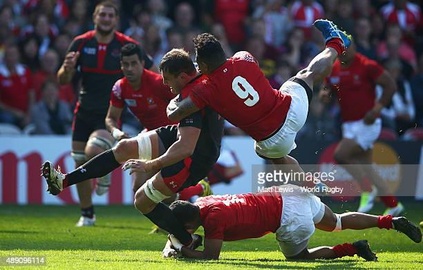 Konstantin Mikautadze of Georgia is tackled by Sonatone Takula of Tonga during the 2015 Rugby World Cup Pool C match between Tonga and Georgia at...
