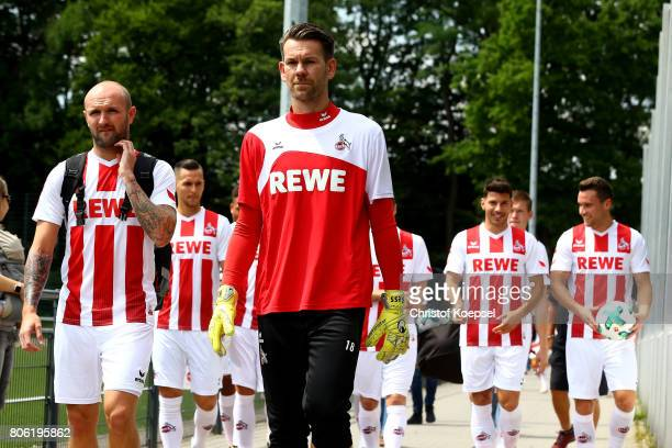 Konstantin Rauch and Thomas Kessler walk to the training session of 1 FC Koeln at RheinEnergieSportpark on July 3 2017 in Cologne Germany