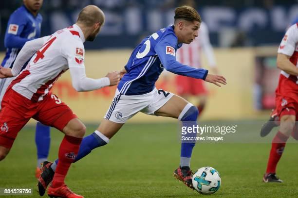 Konstantin Rausch of FC Koln Amine Harit of Schalke 04 during the German Bundesliga match between Schalke 04 v 1 FC Koln at the Veltins Arena on...