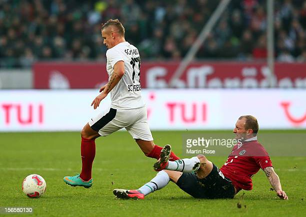 Konstantin Rausch of Hannover and Jonathan Schmid of Freiburg battle for the ball during the Bundesliga match between Hannover 96 and SC Freiburg at...