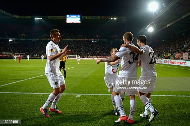 Konstantin Rausch of Hannover and teammates celebrate their team's second goal during the UEFA Europa League Group L match between Twente Enschede...