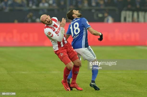 Konstantin Rausch of Koeln and Daniel Caligiuri of Schalke in action during the Bundesliga match between FC Schalke 04 and 1 FC Koeln Bundesliga at...