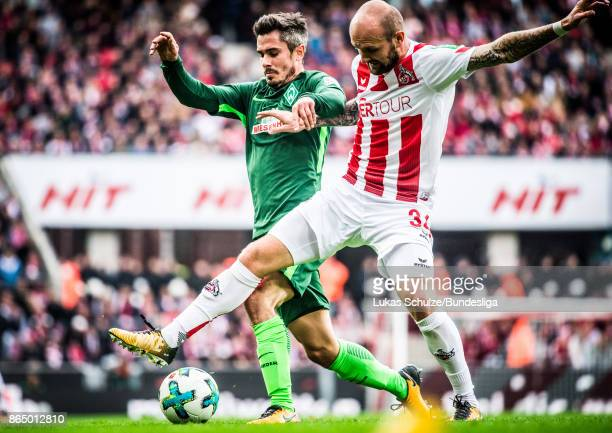 Konstantin Rausch of Koeln and Fin Bartels of Bremen in action during the Bundesliga match between 1. FC Koeln and SV Werder Bremen at...