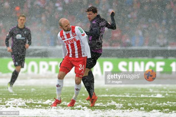 Konstantin Rausch of Koeln and Pascal Stenzel of Freiburg battle for the ball during the Bundesliga match between 1 FC Koeln and SportClub Freiburg...
