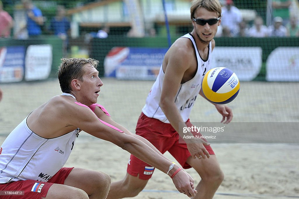 Konstantin Semenov (L) from Russia receives the ball during the match between Russia and the Netherlands during Day 5 of the FIVB World Championships on July 5, 2013 in Stare Jablonki, Poland.