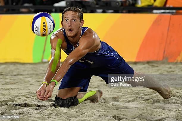 Konstantin Semenov of Russia bumbs the ball during the Men's Beach Volleyball Bronze medal match against Alexander Brouwer and Robert Meeuwsen of...