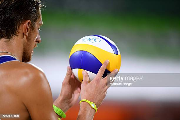 Konstantin Semenov of Russia looks at the ball during the Men's Beach Volleyball Quarterfinal match between the Russia and Cuba on Day 10 of the Rio...