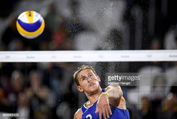 Konstantin Semenov of Russia plays a shot during the Men's Beach Volleyball Quarterfinal match between the Russia and Cuba on Day 10 of the Rio 2016...