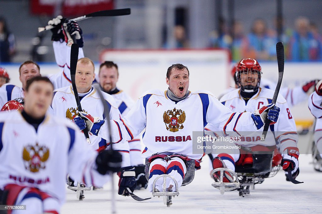 Konstantin Shikhov of Russia celebrates after the Ice Sledge Hockey Preliminary Round Group B match between the United States of America and Russia during day four of Sochi 2014 Paralympic Winter Games at Shayba Arena on March 11, 2014 in Sochi, Russia.