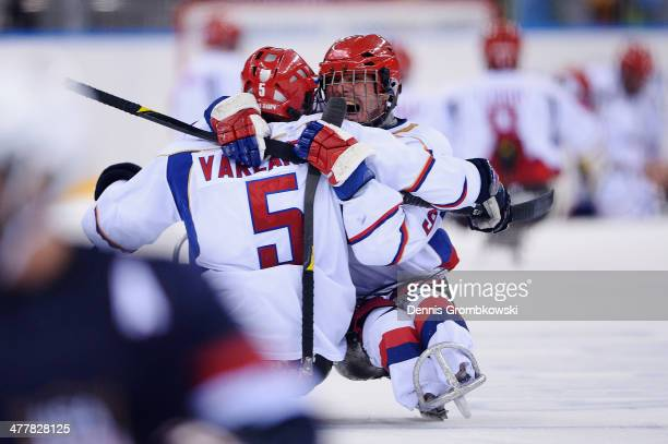 Konstantin Shikhov of Russia celebrates with team mate Vasilii Varlakov after the Ice Sledge Hockey Preliminary Round Group B match between the...