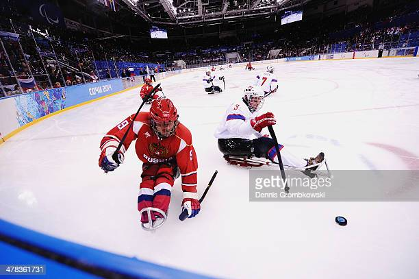 Konstantin Shikhov of Russia is challenged by Rolf Einar Pedersen of Norway during the Ice Sledge Hockey Playoff semi final between Russia and Norway...