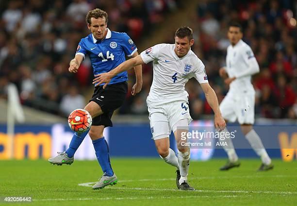 Konstantin Vassiljev of Estonia and James Milner of England during the UEFA EURO 2016 Qualifier match between England and Estonia at Wembley Stadium...