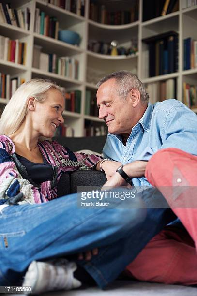 Konstantin Wecker and his wife Annik smile at each other during a private photo session on June 3 2008 in Munich Germany