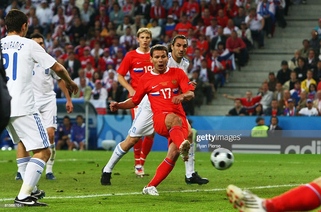 Konstantin Zyrianov of Russia shoots and scores his team first goal of the game during the UEFA EURO 2008 Group D match between Greece and Russia at Stadion Wals-Siezenheim on June 14, 2008 in Salzburg, Austria.