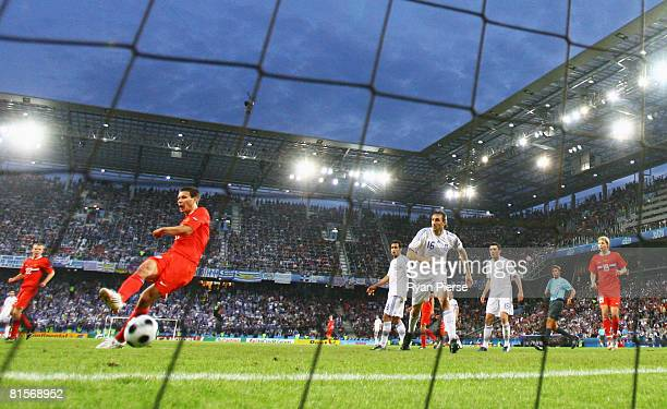 Konstantin Zyrianov of Russia shoots and scores his team first goal of the game during the UEFA EURO 2008 Group D match between Greece and Russia at...